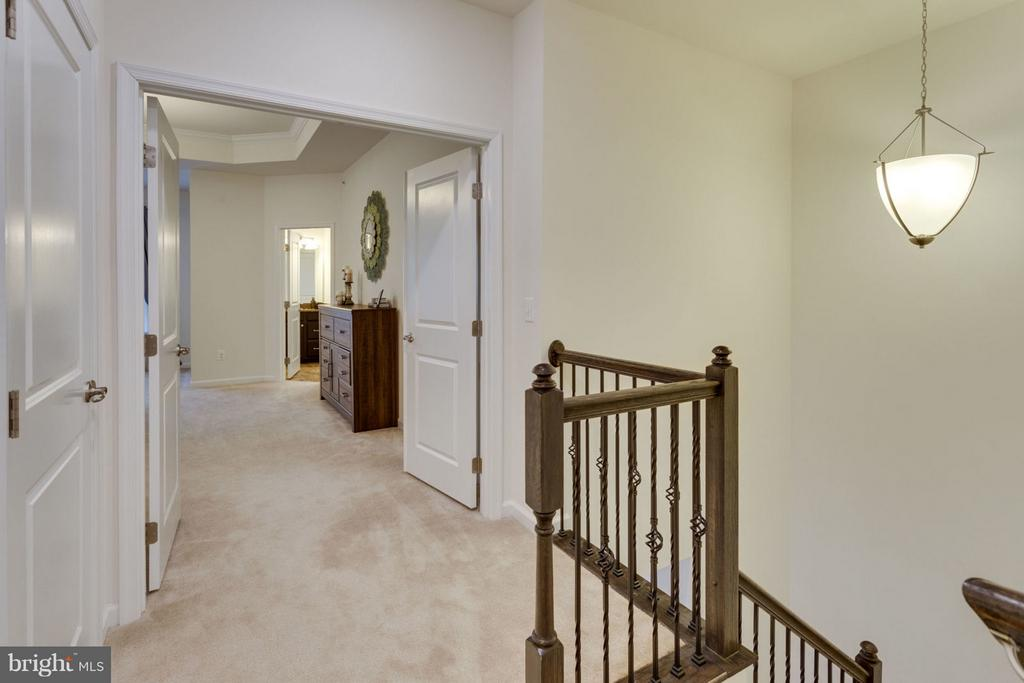 Wooden staircase leads to upper level - 7820 CULLODEN CREST LN, GAINESVILLE