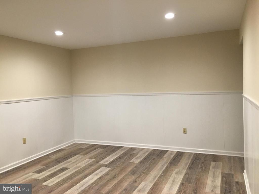 Lower level recreation room with new floor - 8427 BATTLE PARK DR, SPOTSYLVANIA