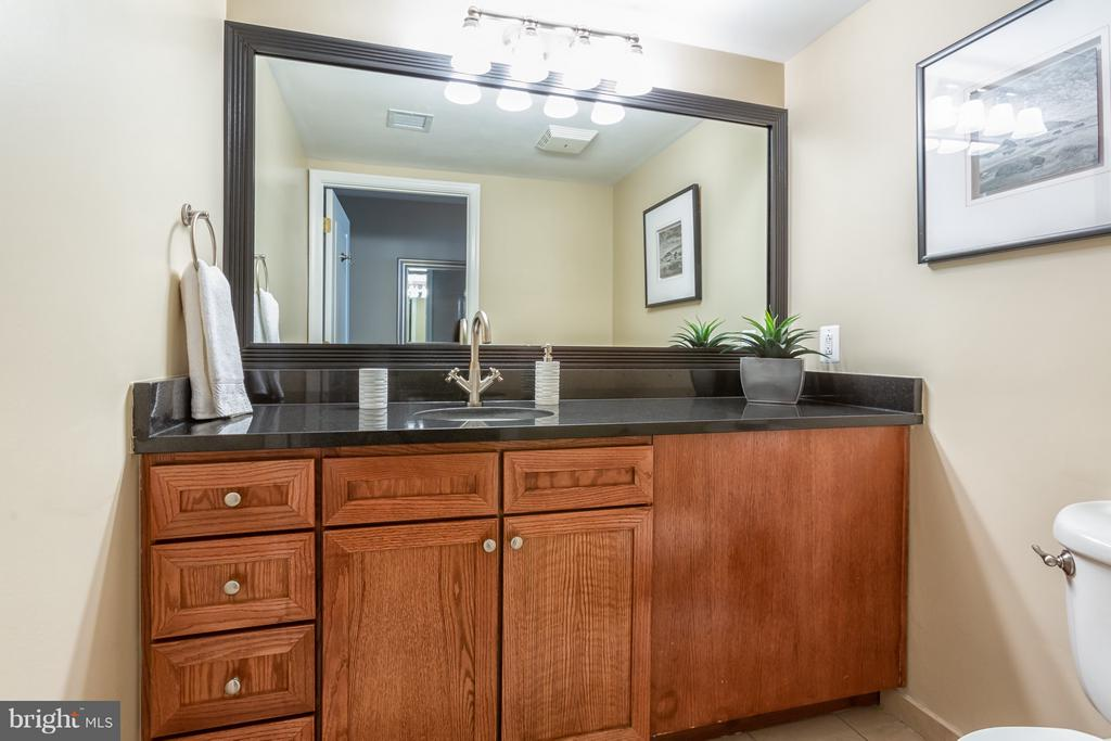 Spacious main level powder room. - 616 E ST NW #1150, WASHINGTON