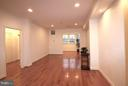 View from kitchen to sun room. Hardwood floors - 10328 SAGER AVE #113, FAIRFAX