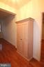 Hall to Master bedroom with attched bult in linen - 10328 SAGER AVE #113, FAIRFAX