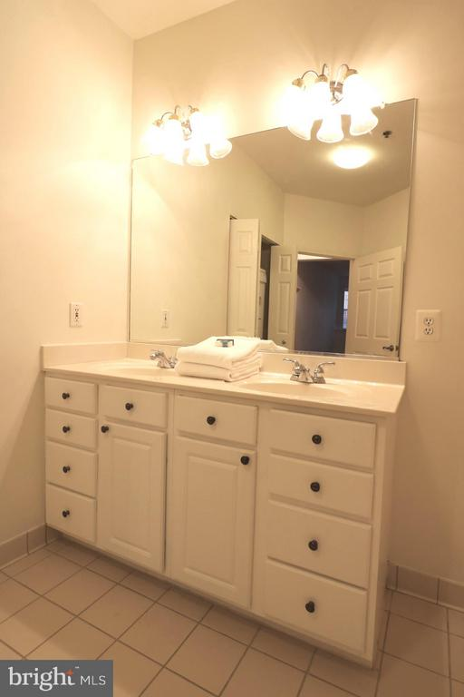 Updated vanity and lighting. - 10328 SAGER AVE #113, FAIRFAX
