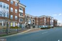 Front of building with circular drive, fountain - 10328 SAGER AVE #113, FAIRFAX