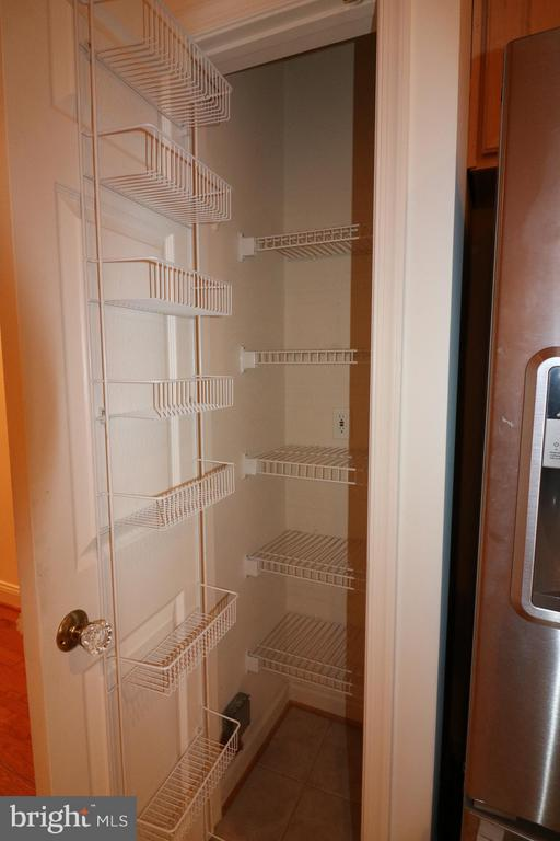 Built in pantry with oodles of shelves - 10328 SAGER AVE #113, FAIRFAX