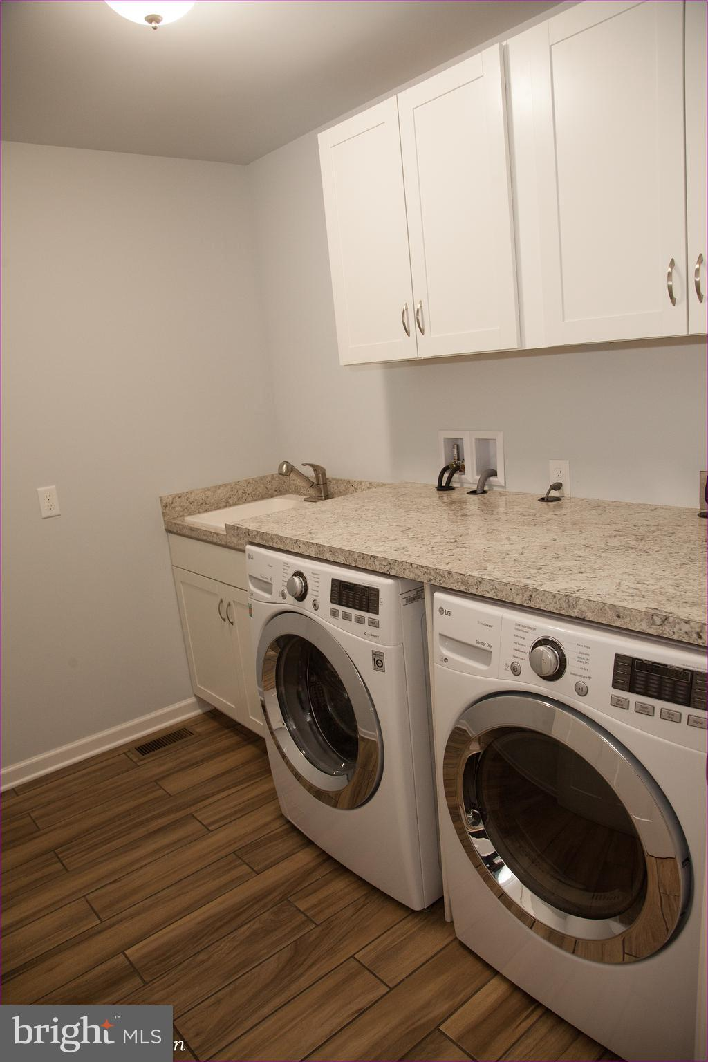 Laundry Rm with Sink, and white cabinets