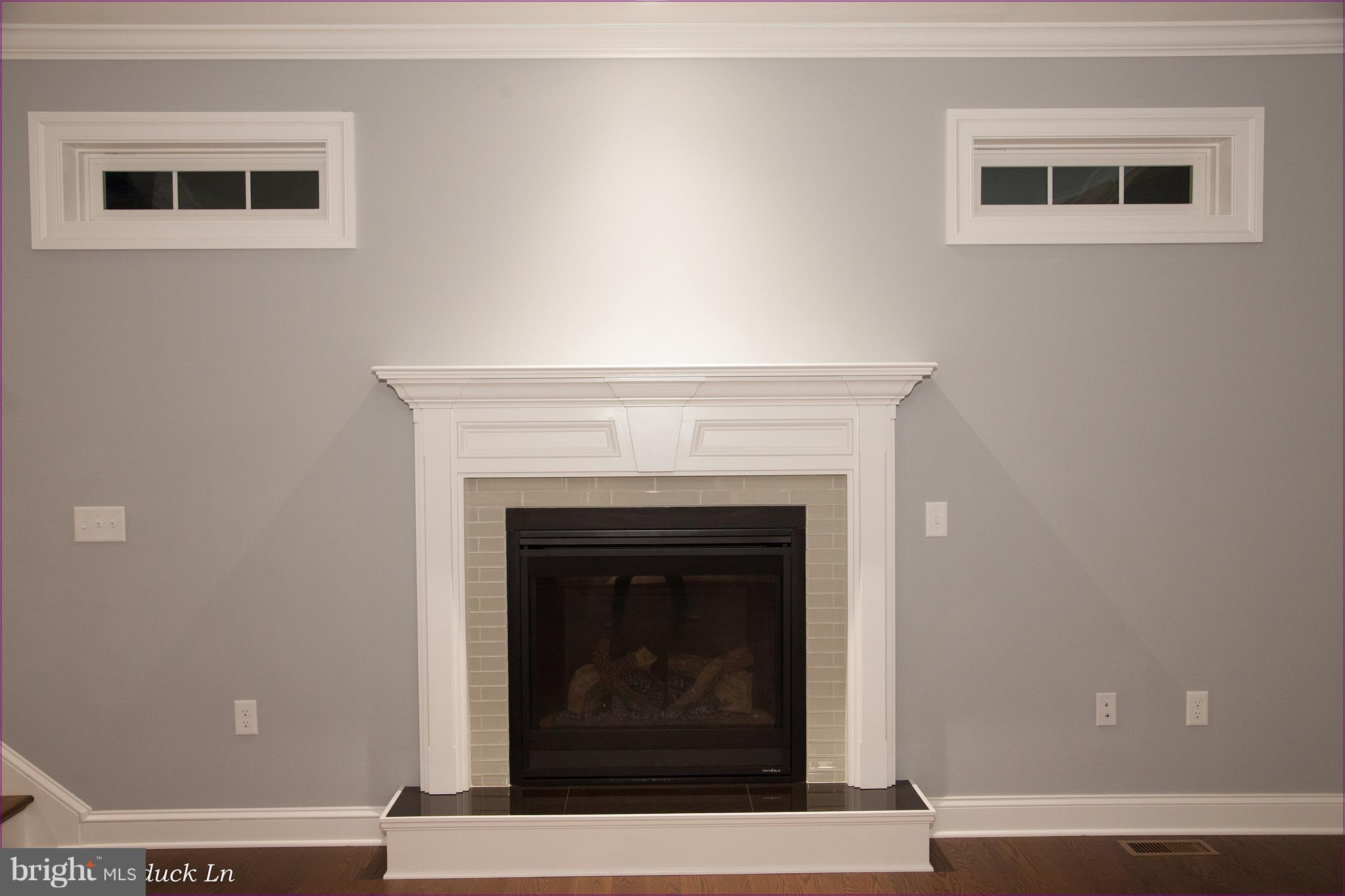 Beautiful Fireplace with Transom Windows