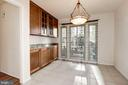 Eat-in kitchen space with abundant natural light - 2025 CHADDS FORD DR, RESTON