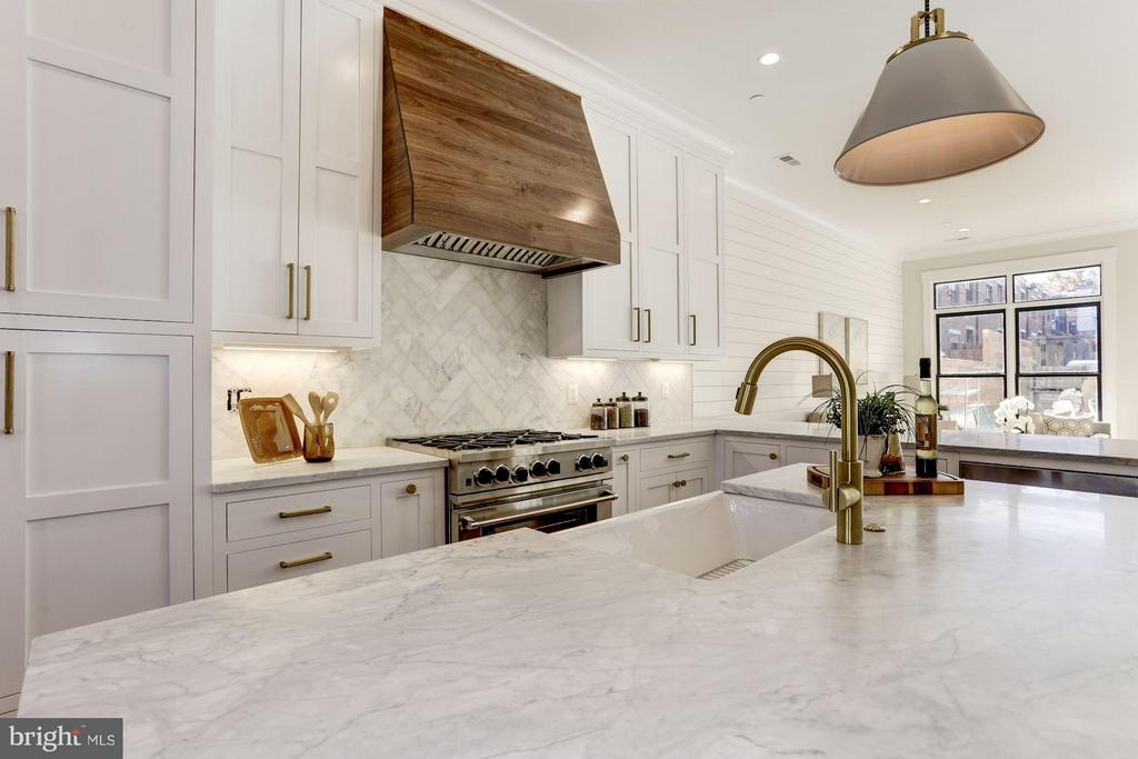 Walnut hood range, white honed carrara marble - 311 F ST NE, WASHINGTON