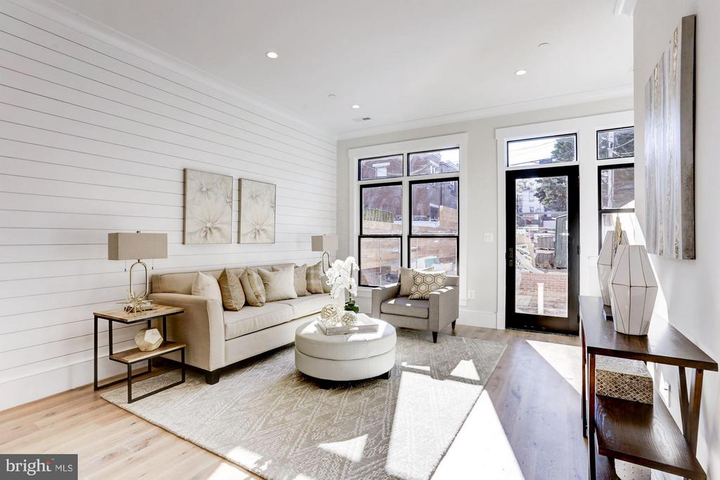 Family room flooded with light, shiplap walls - 311 F ST NE, WASHINGTON