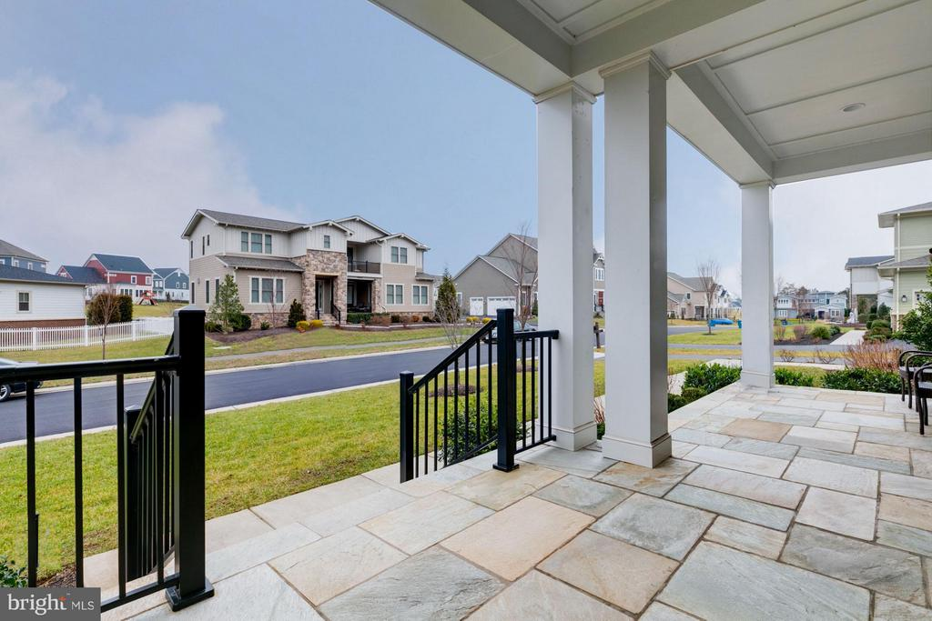 Stone porch makes a great spot to relax - 41629 WHITE YARROW CT, ASHBURN