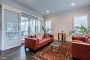 Living room with full sliding plantation shutters - 41629 WHITE YARROW CT, ASHBURN