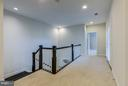 Upper level hallway with access to covered deck - 41629 WHITE YARROW CT, ASHBURN