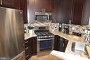 Beautiful cabinets with crown, stunning tilework. - 14320 CLIMBING ROSE WAY #203, CENTREVILLE