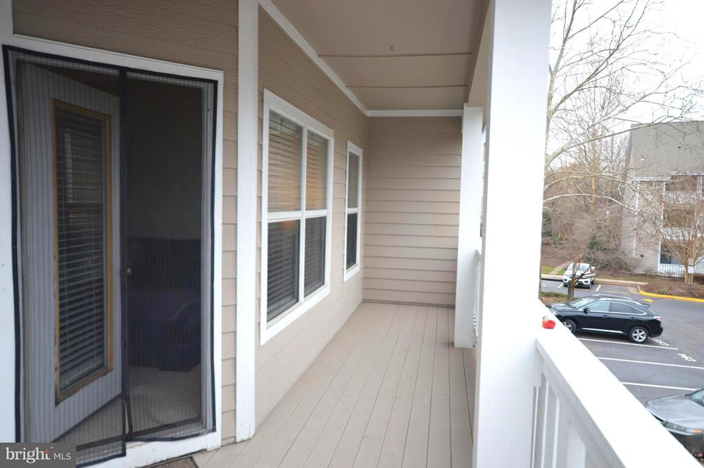 This balcony is large enough for outdoor living - 14320 CLIMBING ROSE WAY #203, CENTREVILLE