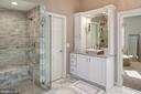 Spa-like glassed in shower, separate vanities. - 5862 SADDLE DOWNS PL, CENTREVILLE