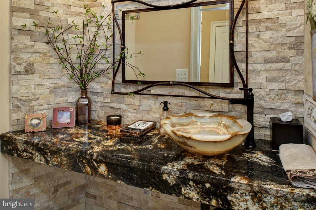 1/2 bath: stone wall, exotic granite, onyx vessel - 5862 SADDLE DOWNS PL, CENTREVILLE