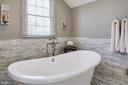 Stone wall, marble inlay &floor mount tub filler. - 5862 SADDLE DOWNS PL, CENTREVILLE