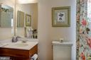 Main level bedroom with  ensuite full bath. - 5862 SADDLE DOWNS PL, CENTREVILLE