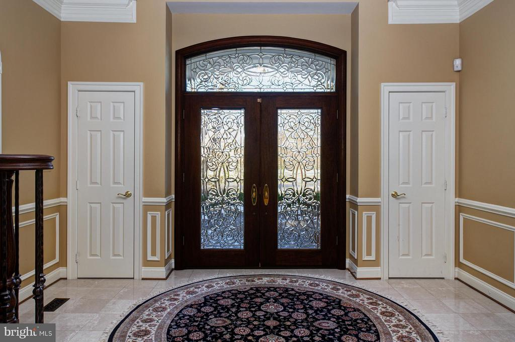 Custom cut-glass front door welcomes you. - 5862 SADDLE DOWNS PL, CENTREVILLE