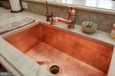 Hammered copper sink and copper fixtures. - 5862 SADDLE DOWNS PL, CENTREVILLE
