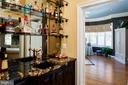 Wet bar with exotic granite  & copper fixtures. - 5862 SADDLE DOWNS PL, CENTREVILLE