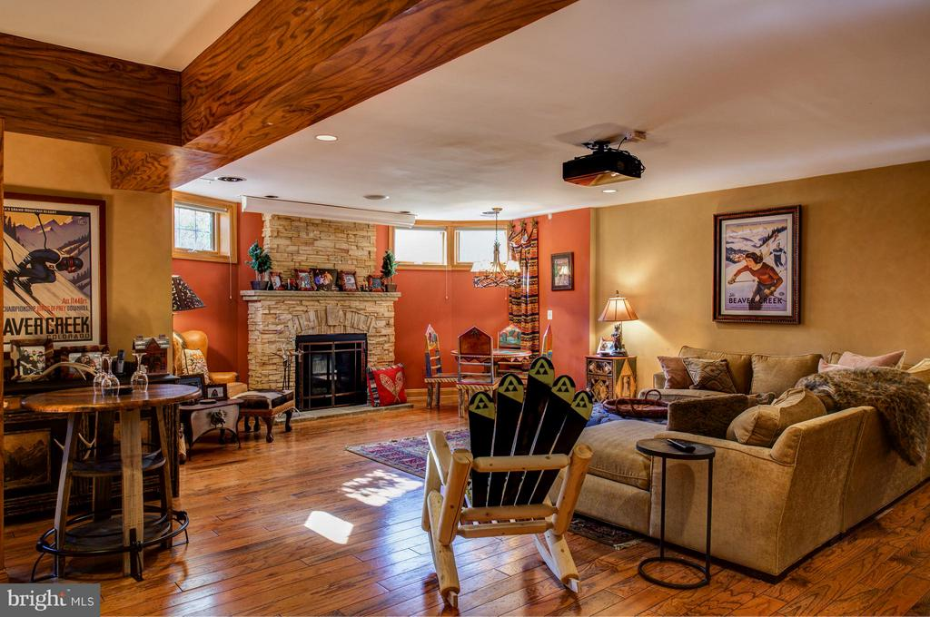 Basement rec room w/ stone fireplace - 5862 SADDLE DOWNS PL, CENTREVILLE