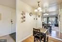 View into DR and entry way with large closet - 2301 GREENERY LN #104-5, SILVER SPRING