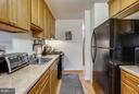 Galley Kitchen w/lots of countertops & storage - 2301 GREENERY LN #104-5, SILVER SPRING