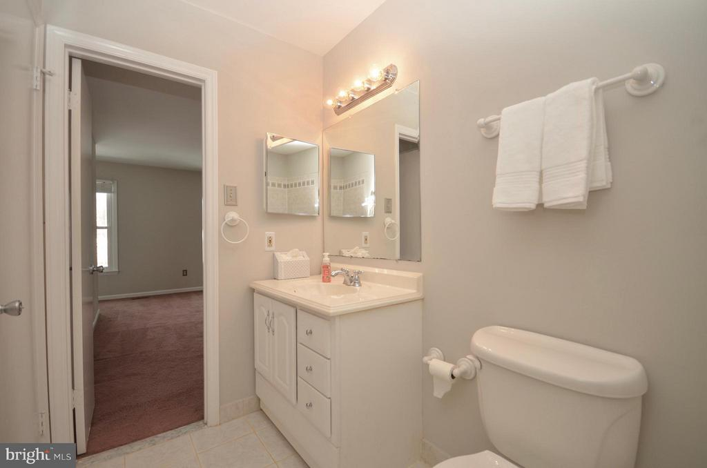 Main bath with modern tile and finish - 14609 BATAVIA DR, CENTREVILLE