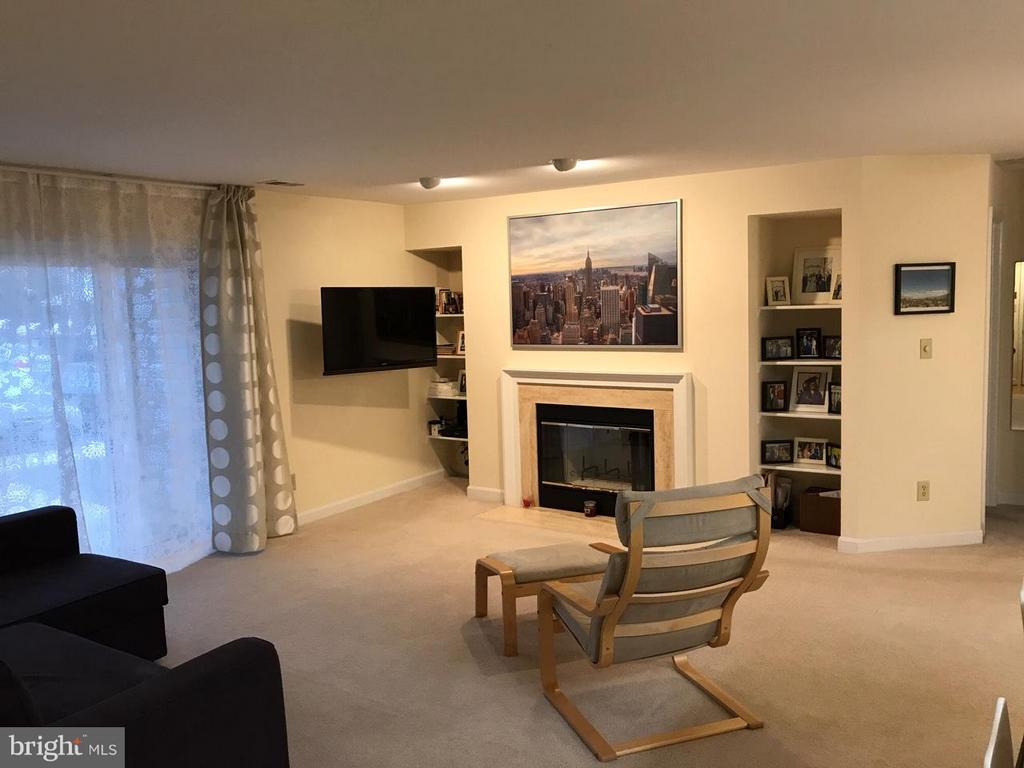 Living room with fireplace - 13702 MODRAD WAY #8-B-21, SILVER SPRING
