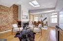 Main Level - Dining Room w/ Fireplace and Skylight - 1416 21ST ST NW #301, WASHINGTON