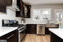 White Krion counters throughout kitchen. - 541 SHEPHERD ST NW, WASHINGTON