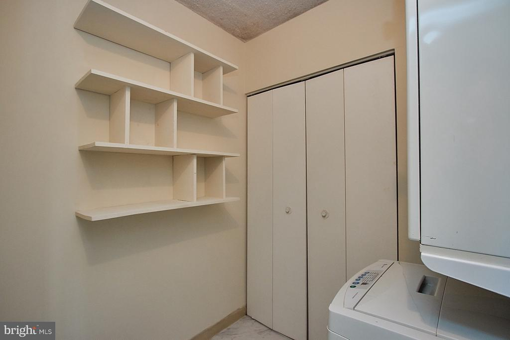 Shelving and storage in laundry room! - 5500 HOLMES RUN PKWY #805, ALEXANDRIA