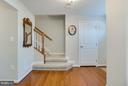 Coat Closet and Carpeted Stair Platform - 117 SWEETGUM CT, STAFFORD