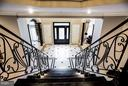 Stairway from upper level to foyer - 534 UTTERBACK STORE RD, GREAT FALLS