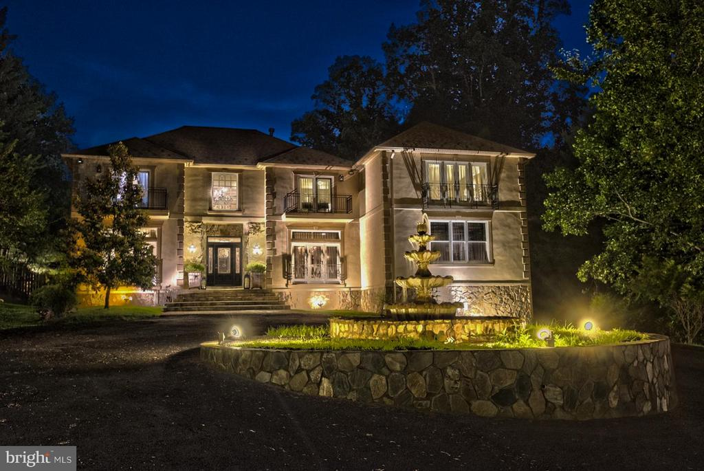 Night shots of home with fountain - 534 UTTERBACK STORE RD, GREAT FALLS