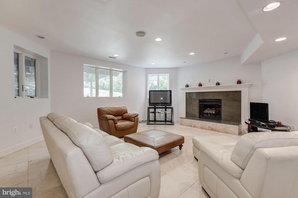 Lower level recreation room with fireplace - 534 UTTERBACK STORE RD, GREAT FALLS