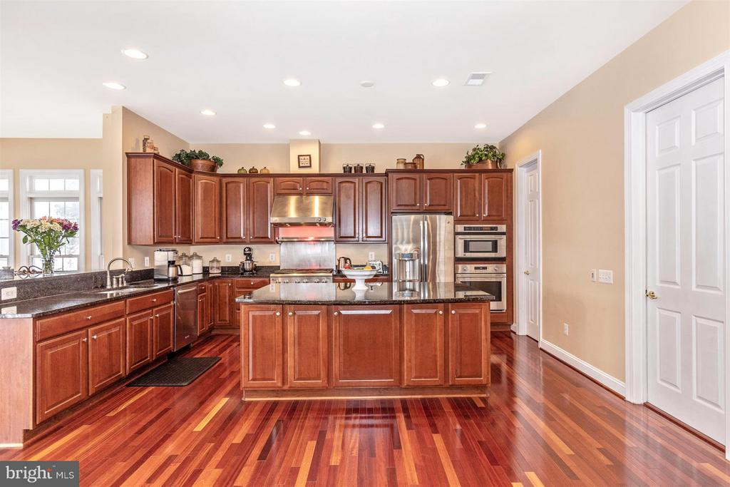 View from table space in kitchen towards island - 4207 MARYLAND CT, MIDDLETOWN