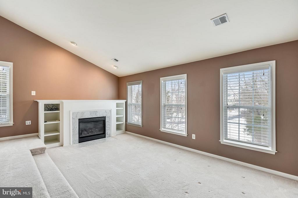 You'll love the sitting room with fireplace. - 21409 STURMAN PL, BROADLANDS