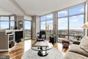 Family room opens to curved balcony - 11990 MARKET ST #913, RESTON