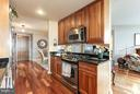 Open kitchen makes entertaining a breeze! - 11990 MARKET ST #913, RESTON