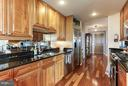 Custom mirrored backsplash and gorgeous hardwoods - 11990 MARKET ST #913, RESTON