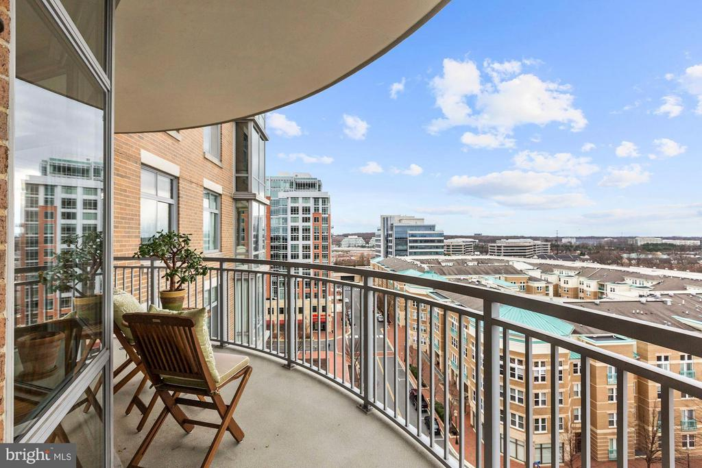 Curved balcony offers space to sit back & relax - 11990 MARKET ST #913, RESTON