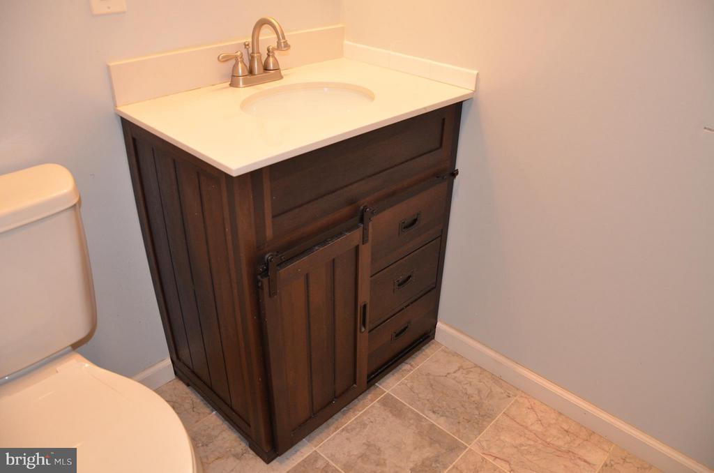 Basement Bathroom/angle - 7546 NW 8TH ST NW, WASHINGTON