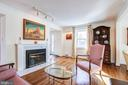 Living Room with gas fireplace - 7013 EXFAIR RD, BETHESDA