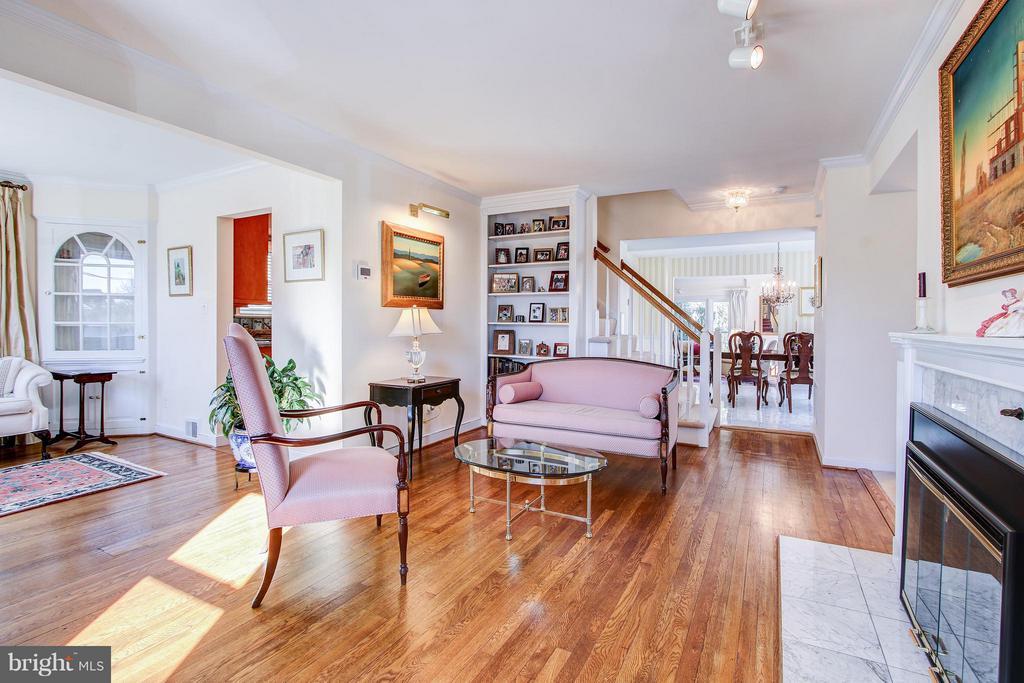 Living Room with custom built ins - 7013 EXFAIR RD, BETHESDA