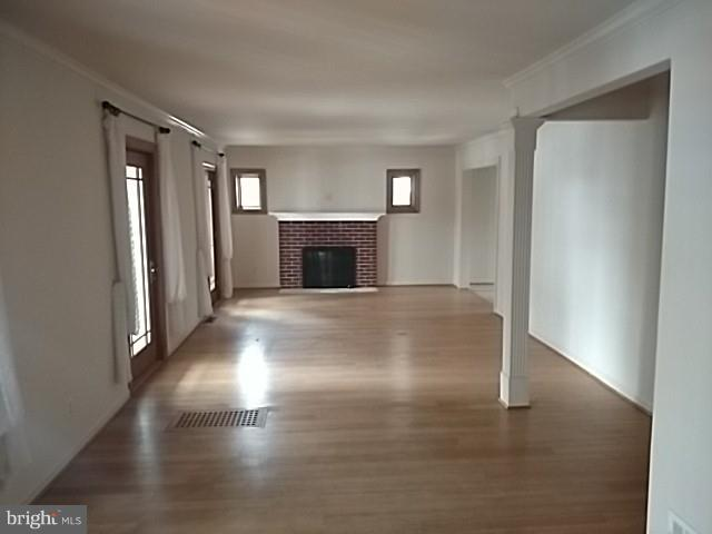 Living room with fireplace. - 10007 BROAD ST, BETHESDA