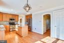 Kitchen with Updated  Lighting in Eating Area - 39877 THOMAS MILL RD, LEESBURG