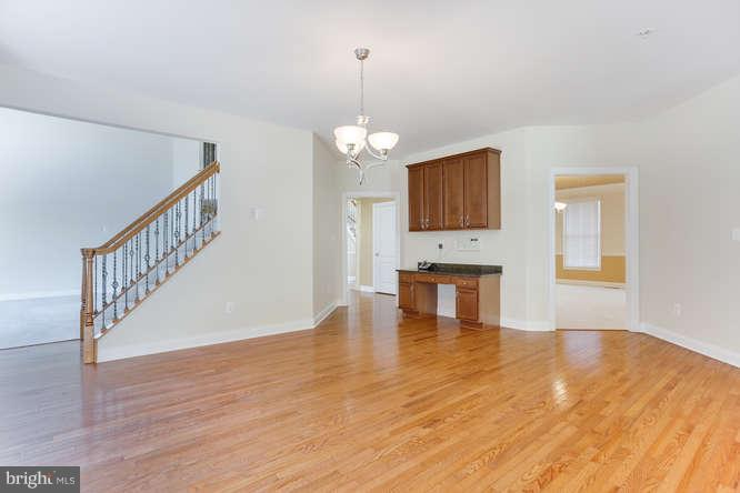 Eat in kitchen with gleaming hardwood floors - 8510 KITTAMA DR, CLINTON