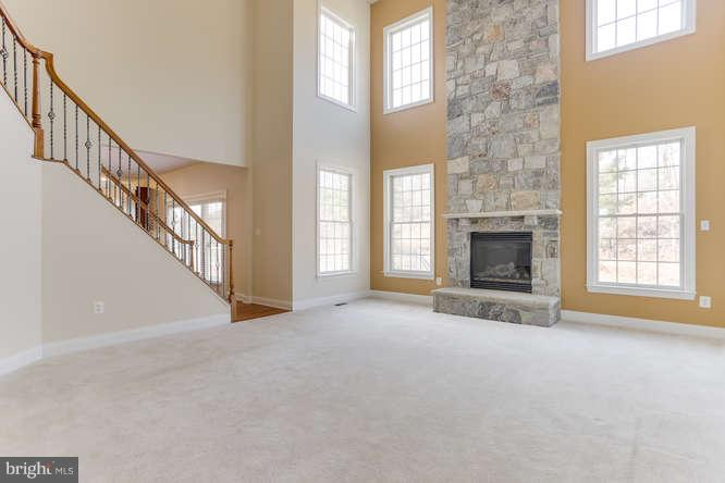 Family room with stone fireplace - 8510 KITTAMA DR, CLINTON